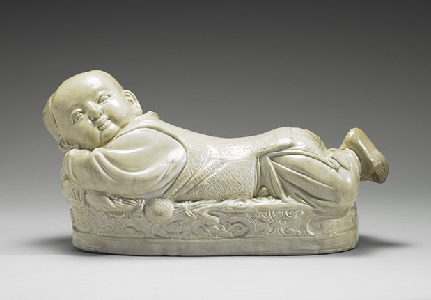 Ting Ware White Ceramic Pillow in the Shape of a Child