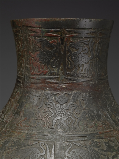 Hu vessel with Hunting Scenes Inlaid in Copper-like Paste