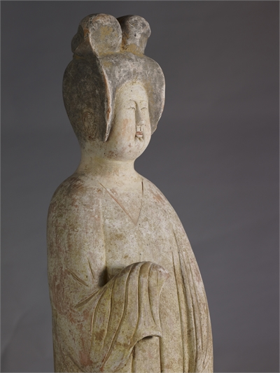 Pottery figure of a standing lady with painted colors
