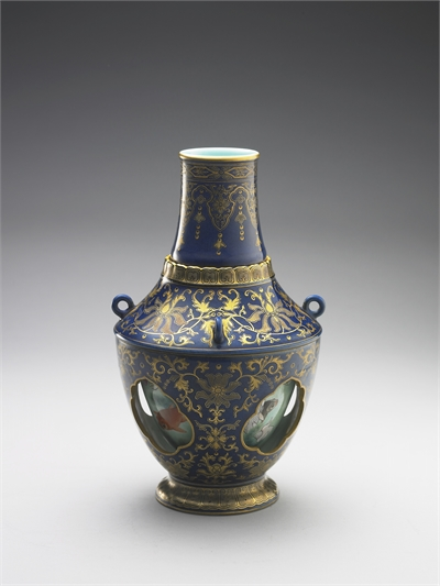 Revolving vase with swimming fish in cobalt blue glaze