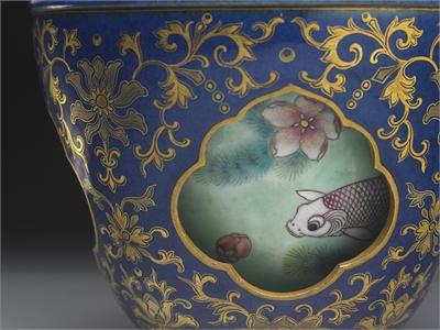 Revolving vase with swimming fish in cobalt blue glaze