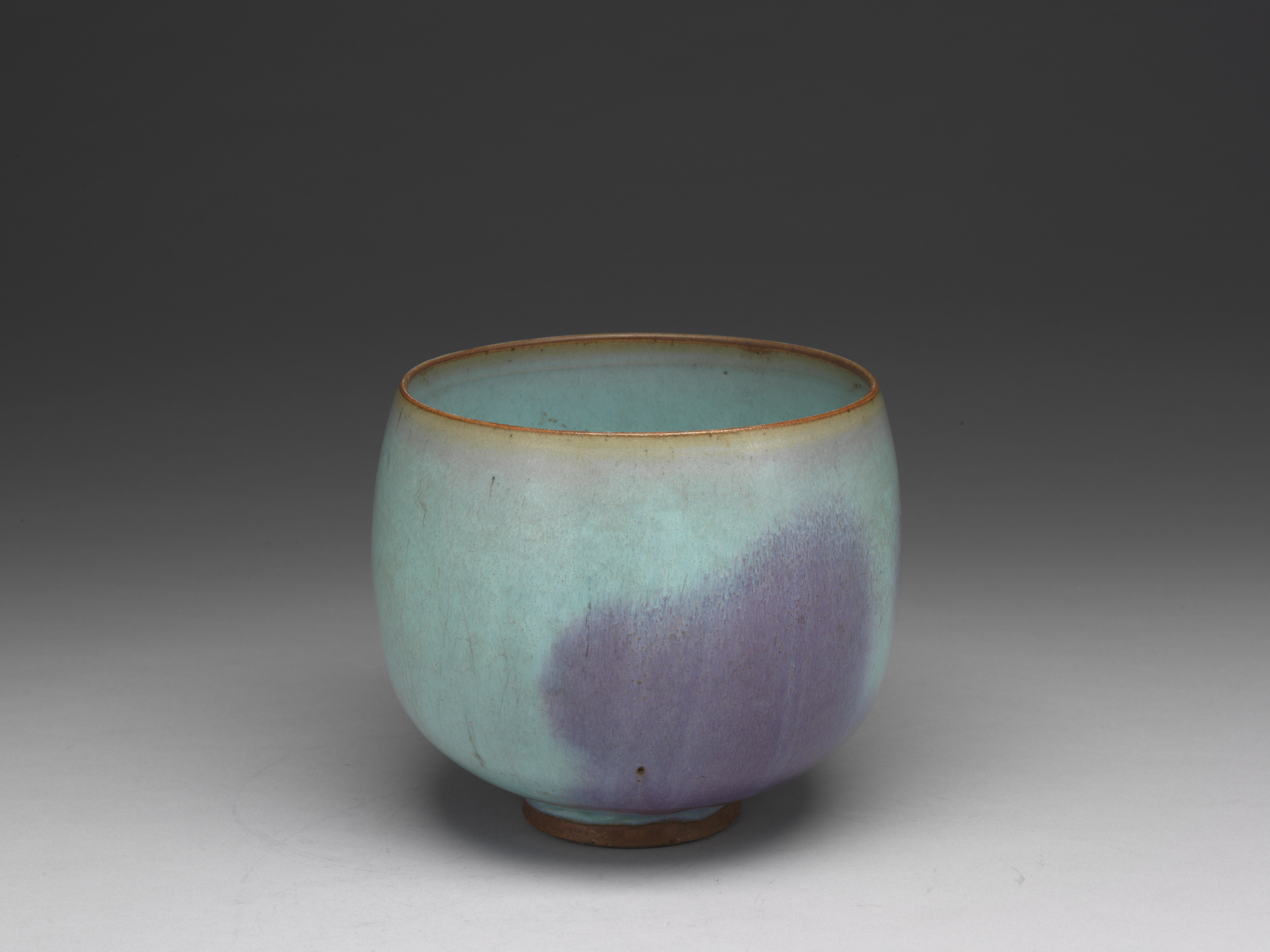 Bowl with sky-blue glaze and purple splashes