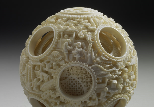 Ivory balls of nested concentric layers with human figures in openwork relief
